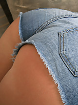 Spunky brunette pulls off denim shorts to show off her cute blue thong