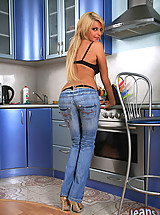 Tight jeans hug this blond's ass as she peels them off to show panties